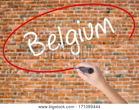 Woman Hand Writing Belgium  With Black Marker On Visual Screen