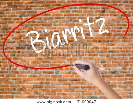 Woman Hand Writing Biarritz  With Black Marker On Visual Screen