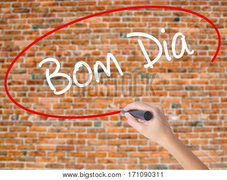 "Woman Hand Writing ""bom Dia"" (in Portuguese - Good Morning)  With Black Marker On Visual S"