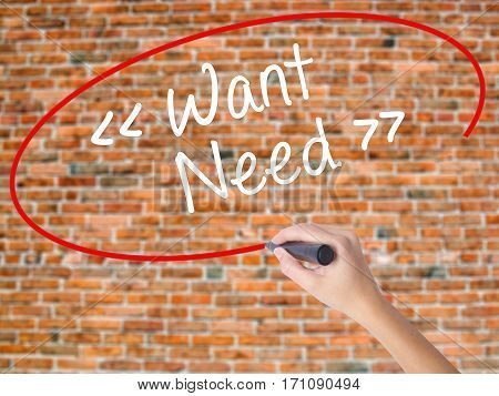 Woman Hand Writing Want - Need With Black Marker On Visual Screen.