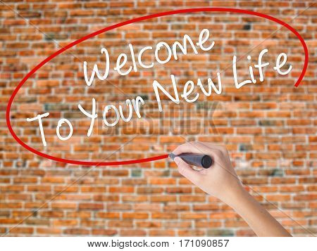 Woman Hand Writing Welcome To Your New Life With Black Marker On Visual Screen