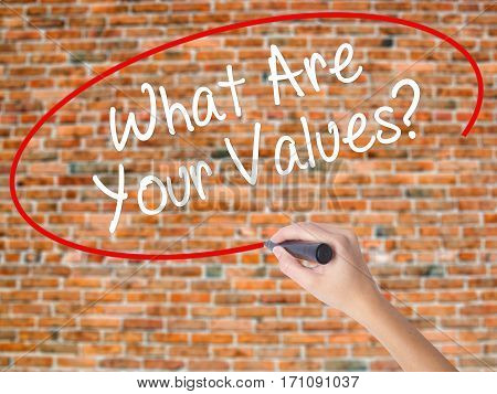 Woman Hand Writing What Are Your Values? With Black Marker On Visual Screen