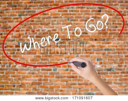 Woman Hand Writing Where To Go? With Black Marker On Visual Screen