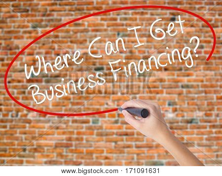 Woman Hand Writing Where Can I Get Business Financing? With Black Marker On Visual Screen.