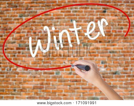 Woman Hand Writing Winter With Black Marker On Visual Screen