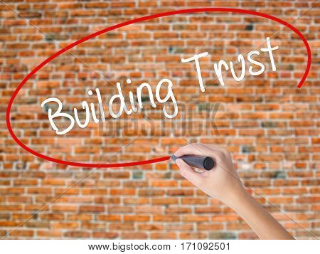 Woman Hand Writing Building Trust With Black Marker On Visual Screen