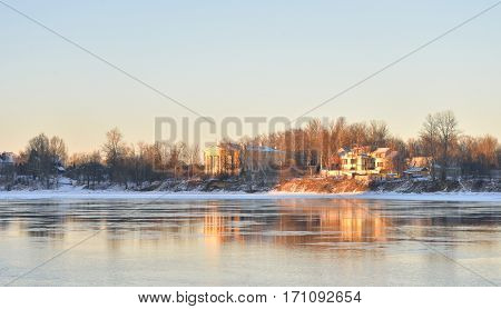 View of Neva River and Lutheran Church of St. Catherine on the outskirts of St. Petersburg at sunny winter evening Russia.