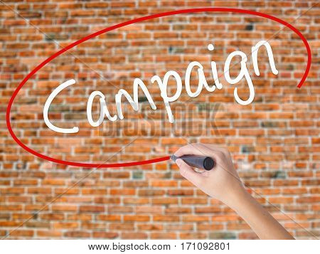 Woman Hand Writing Campaign With Black Marker On Visual Screen