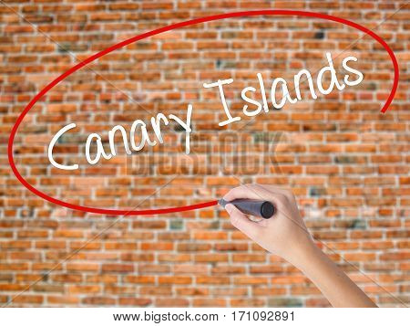 Woman Hand Writing Canary Islands With Black Marker On Visual Screen