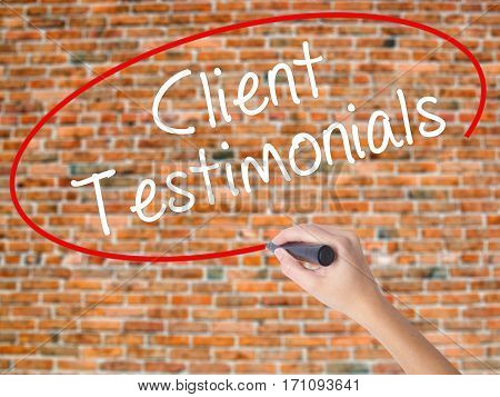 Woman Hand Writing Client Testimonials With Black Marker On Visual Screen