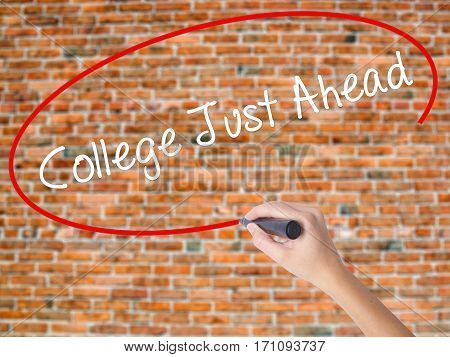 Woman Hand Writing College Just Ahead  With Black Marker On Visual Screen