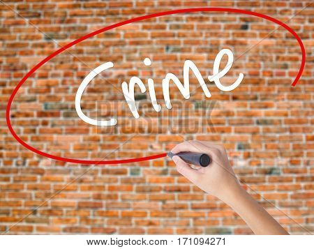 Woman Hand Writing Crime With Black Marker On Visual Screen