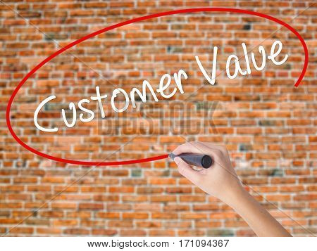 Woman Hand Writing Customer Value With Black Marker On Visual Screen