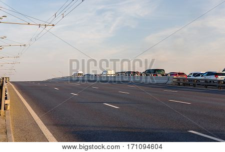 The highway with empty lanes at dusk