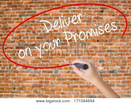 Woman Hand Writing Deliver On Your Promises With Black Marker On Visual Screen