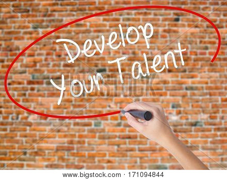 Woman Hand Writing Develop Your Talent With Black Marker On Visual Screen.