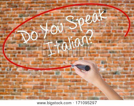 Woman Hand Writing Do You Speak Italian? With Black Marker On Visual Screen