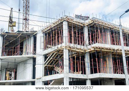 Construction site building against crane close up