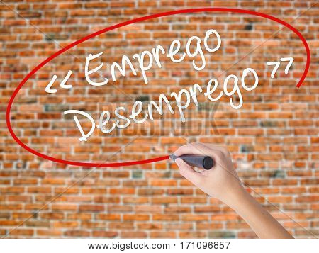 Woman Hand Writing Emprego Desemprego (employment - Unemployment In Portuguese)  With Black Marker O