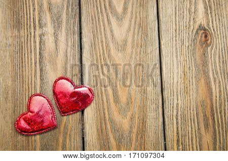 Two hearts on a wooden background. Holiday background