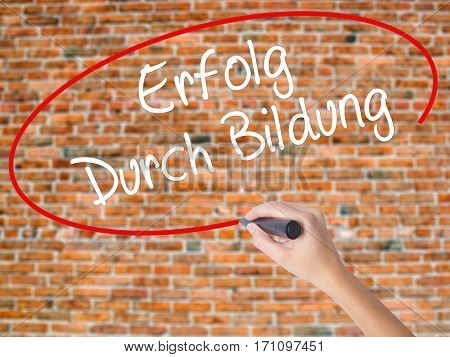 Woman Hand Writing Erfolg Durch Bildung  (success Through Training In German) With Black Marker On V