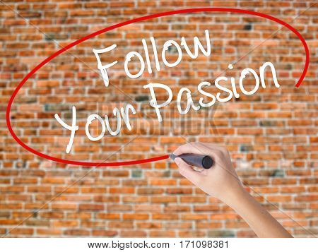 Woman Hand Writing  Follow Your Passion With Black Marker On Visual Screen