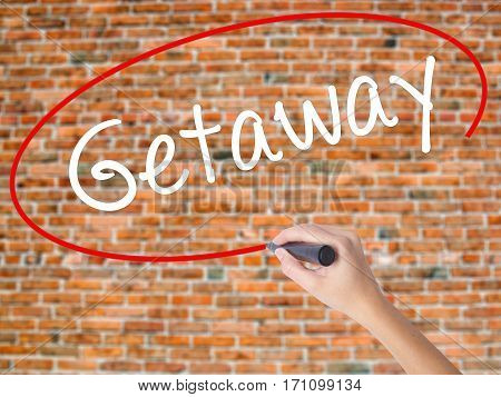 Woman Hand Writing Getaway With Black Marker On Visual Screen