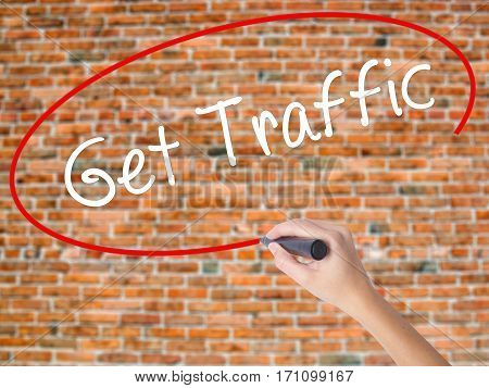 Woman Hand Writing Get Traffic With Black Marker On Visual Screen