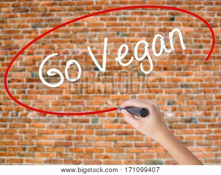 Woman Hand Writing Go Vegan With Black Marker On Visual Screen