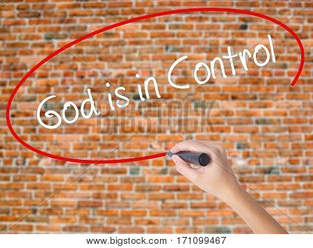 Woman Hand Writing God Is In Control With Black Marker On Visual Screen