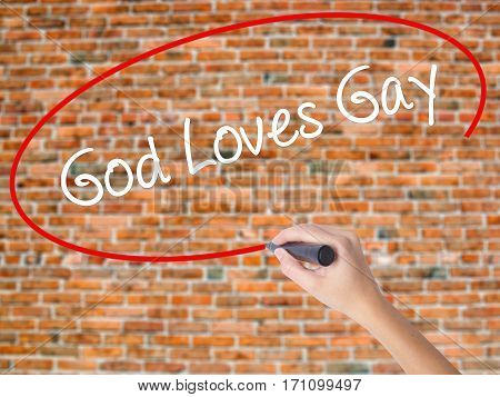 Woman Hand Writing God Loves Gay With Black Marker On Visual Screen