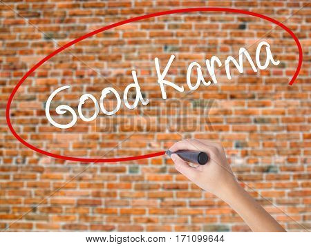 Woman Hand Writing  Good Karma With Black Marker On Visual Screen