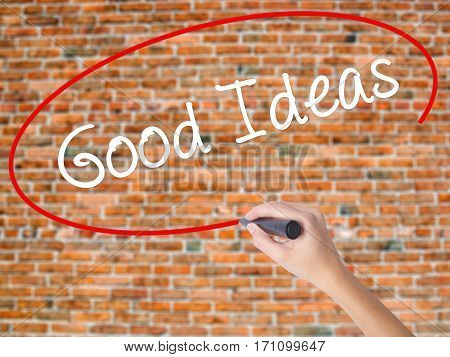 Woman Hand Writing Good Ideas With Black Marker On Visual Screen.
