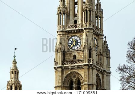 Clock on the main tower of the Vienna city hall (Wiener Rathaus). Vienna, Austria. Wiener Rathaus is the city hall of Vienna, located on Rathausplatz in the Innere Stadt district. Constructed from 1872 to 1883 in a Neo-Gothic style.