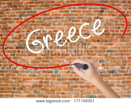 Woman Hand Writing Greece  With Black Marker On Visual Screen