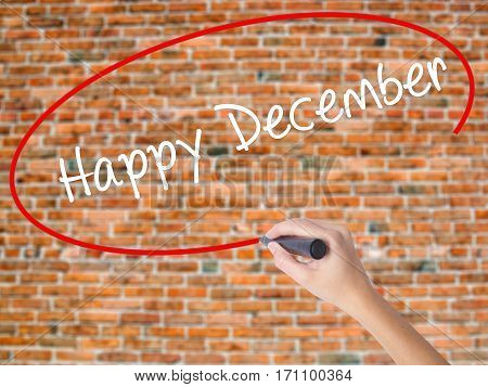 Woman Hand Writing Happy December With Black Marker On Visual Screen