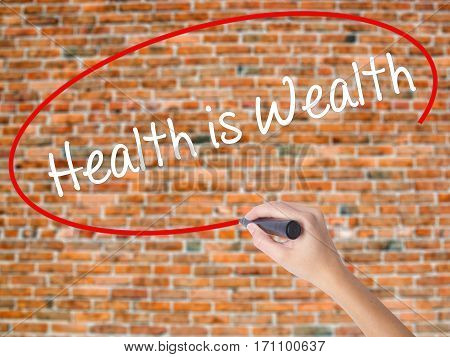 Woman Hand Writing Health Is Wealth With Black Marker On Visual Screen