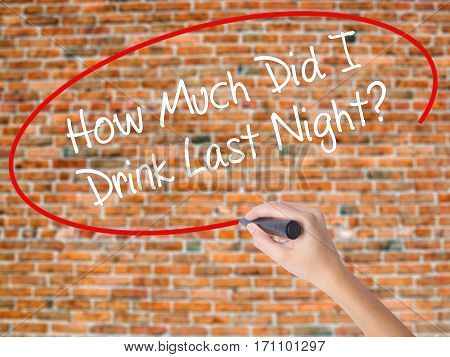 Woman Hand Writing How Much Did I Drink Last Night? With Black Marker On Visual Screen
