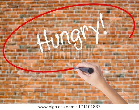 Woman Hand Writing Hungry! With Black Marker On Visual Screen