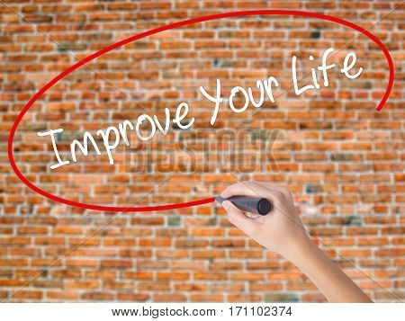 Woman Hand Writing Improve Your Life With Black Marker On Visual Screen.
