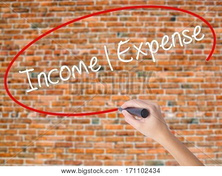 Woman Hand Writing Income Expense With Black Marker On Visual Screen