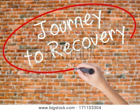 Woman Hand Writing Journey To Recovery With Black Marker On Visual Screen