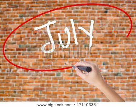 Woman Hand Writing July With Black Marker On Visual Screen