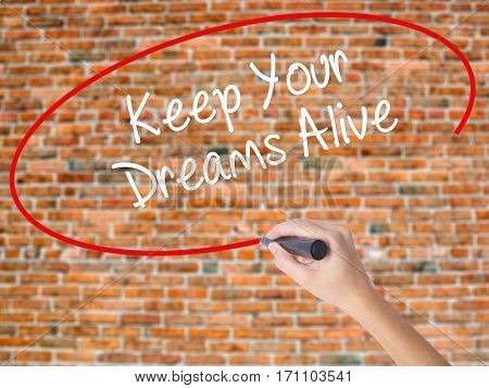 Woman Hand Writing Keep Your Dreams Alive With Black Marker On Visual Screen