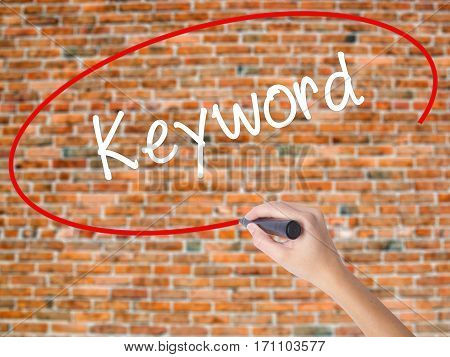 Woman Hand Writing Keyword With Black Marker On Visual Screen
