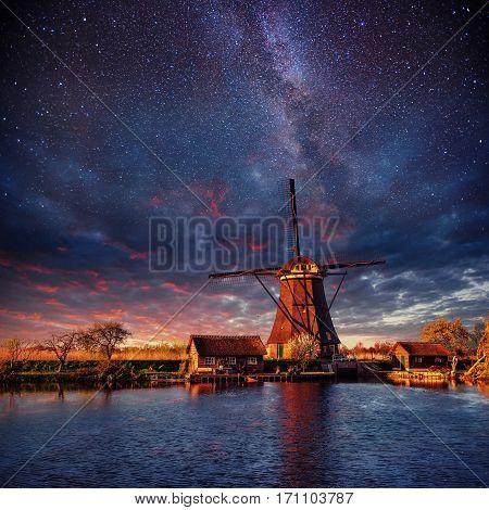 Dutch mill at night. Starry sky. Holland Netherlands