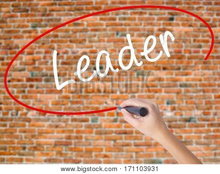 Woman Hand Writing Leader With Black Marker On Visual Screen