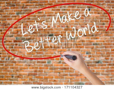 Woman Hand Writing Let's Make A Better World With Black Marker On Visual Screen