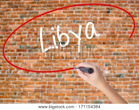 Woman Hand Writing Libya  With Black Marker On Visual Screen