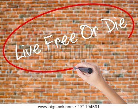 Woman Hand Writing Live Free Or Die With Black Marker On Visual Screen.